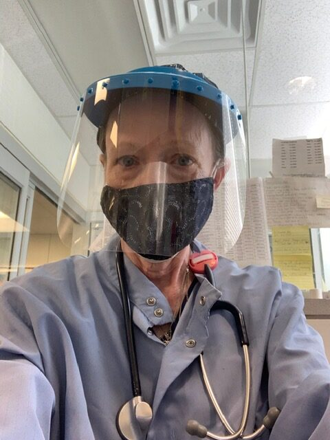 DIY cloth face mask worn behind a protective shield at Forest Park Dialysis Center.